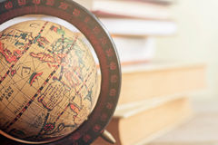 Globe in the library. Stock Photo