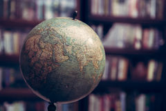 Globe in a library. Close up of an antique globe in a library with barrister book cases from 1920s era Royalty Free Stock Photography