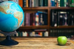 The globe in the library school, university, college on the table. Travel, learning and study concept. Copy space. The globe in the library school, university stock images