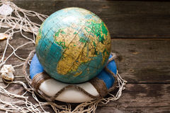 Globe on the lifebuoy earth day and save the world Royalty Free Stock Images