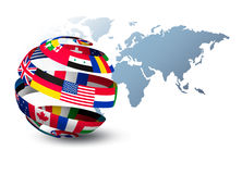 Globe made out of flags on a world map background. Stock Photo