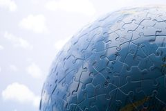 Globe made from puzzle. Blue planet earth from puzzle Stock Image