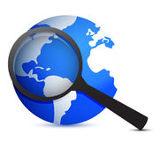 Globe and magnifier Royalty Free Stock Image