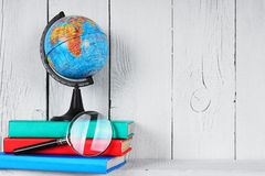 The globe, magnifier and books . Royalty Free Stock Photos