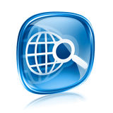 Globe and magnifier icon blue glass. Stock Images