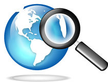 GLOBE WITH MAGNIFY GLASS Royalty Free Stock Photography