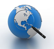 Globe and Magnify glass Stock Images