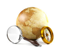 Globe with magnifying glass and compass Stock Photos