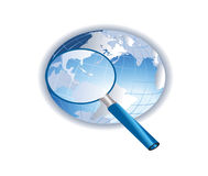Globe with magnifying glass Royalty Free Stock Photos
