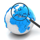 Globe with magnifying glass over Europe Royalty Free Stock Photo