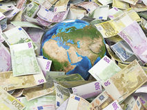 Globe and many euro bills Stock Images