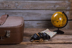 Globe with map and binoculars. Royalty Free Stock Image