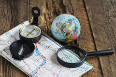 Globe, map and compass Stock Photo