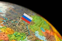 Globe map detail Russia with Russian Flag. Map with miniature Flag of Russia. Selective focus on Russian Flag in Moscow Stock Photography