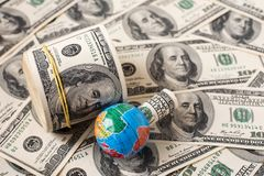 Globe map over many american dollar banknotes.  Stock Photo