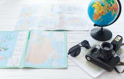 Globe and map on white background with camera. The concept of travel stock photos
