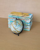 Globe and maps on wood table royalty free stock photos