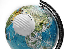 Globe with mask Stock Photography