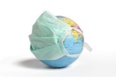 Globe With a Mask Stock Images
