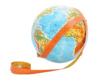 Globe with measure tape Royalty Free Stock Photos