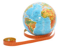 Globe with measure tape. On it Royalty Free Stock Photo