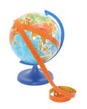 Globe with measure tape. On it Royalty Free Stock Photos