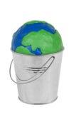 Globe in a metal bucket Royalty Free Stock Photos
