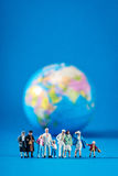 Globe and miniature people Stock Photo