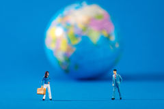 Globe and miniature people Royalty Free Stock Image