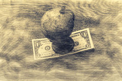 Globe and money. Globe and money in a blurry abstract space royalty free stock photo