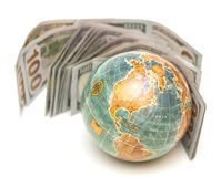 Globe with money. Global concept stock photo
