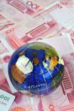 Globe and money notes Royalty Free Stock Photo