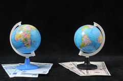 Globe and Money Stock Photo