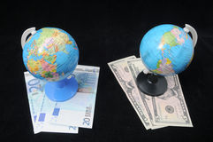 Globe and Money Stock Images