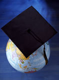Globe with mortar board Royalty Free Stock Photos