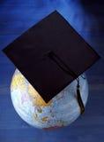 Globe with mortar board Royalty Free Stock Photos