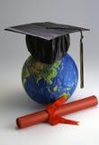 Globe with mortar board Stock Photo
