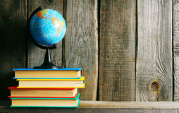 The globe and multi-coloured books. Stock Images