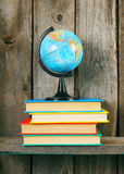 The globe and multi-coloured books. Royalty Free Stock Images