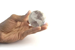 Globe at my tips. Stock phot of the globe at the tips of a hand Royalty Free Stock Images
