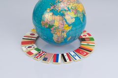 Globe and national flags of the world royalty free stock photography