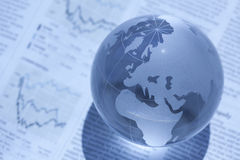 Globe and newspaper. It is an image of global finance Stock Photography