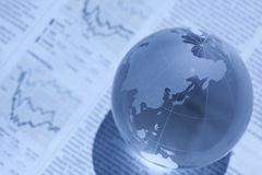 Globe and newspaper. It is an image of international finance Stock Images