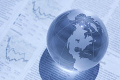 Globe and newspaper. It is an image of global finance Royalty Free Stock Photography