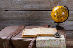 Globe next to opened book. Royalty Free Stock Photography
