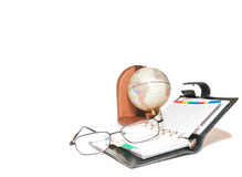 Globe, notebook and glasses Stock Images