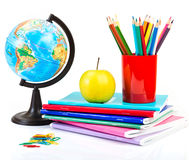 Globe, notebook stack and pencils. Stock Photo