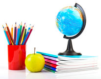 Globe, notebook stack and pencils. Royalty Free Stock Photography