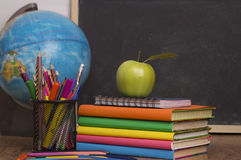 Globe, notebook stack and pencils. Schoolchild and student studies accessories. Royalty Free Stock Photos