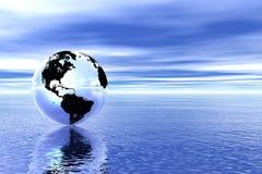 Globe in ocean Stock Photography